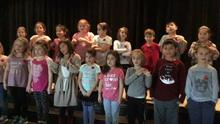 Grade 1FI performance at the Remembrance Day ceremony